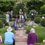 Listening to the story of the building of the herb garden